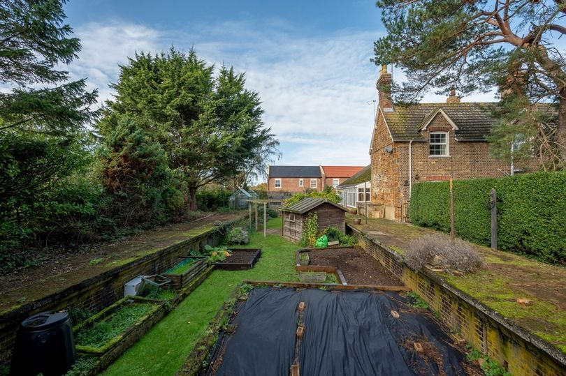 Quirky train station home with tracks and platforms in garden selling for £675k